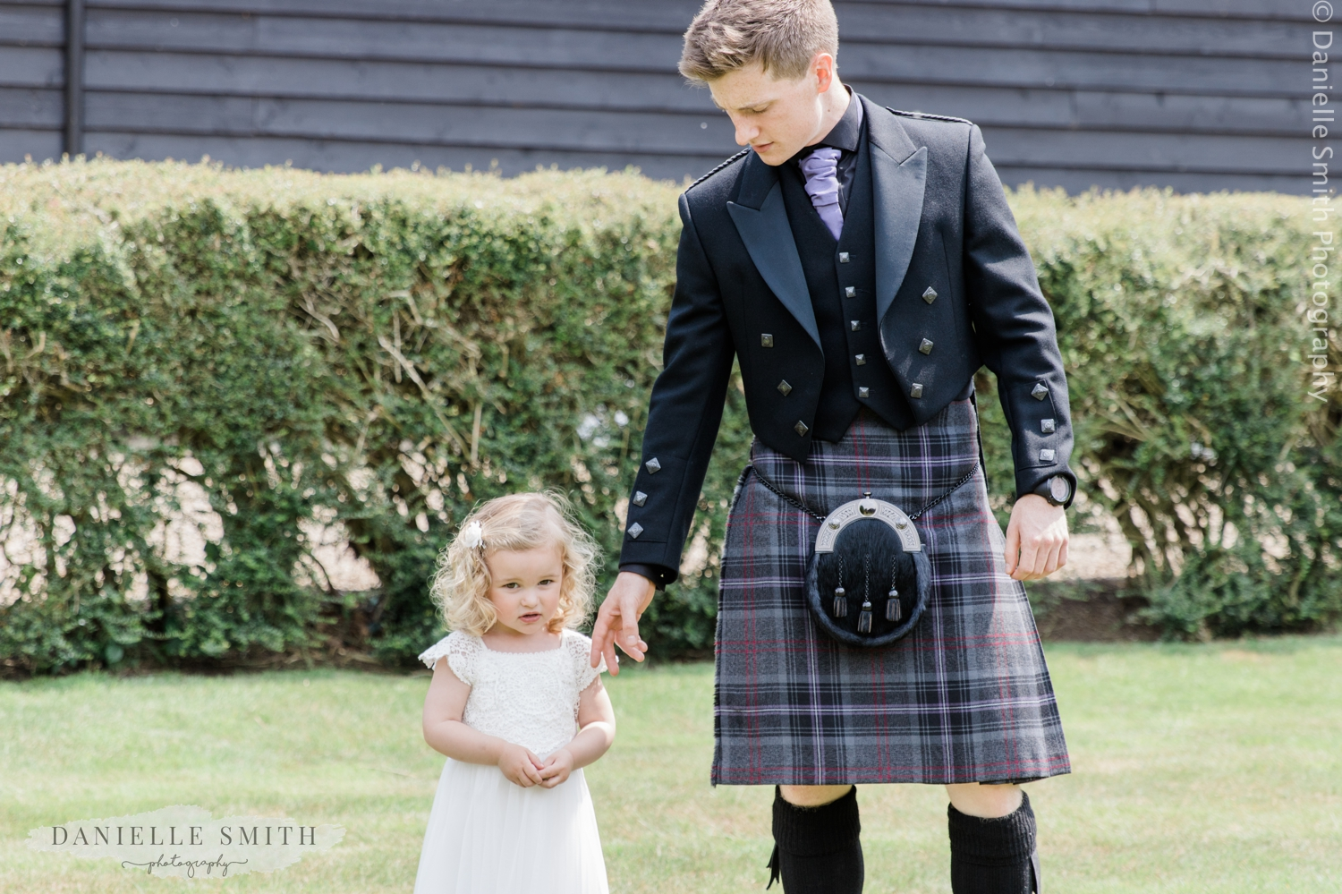 father in kilt with flower girl