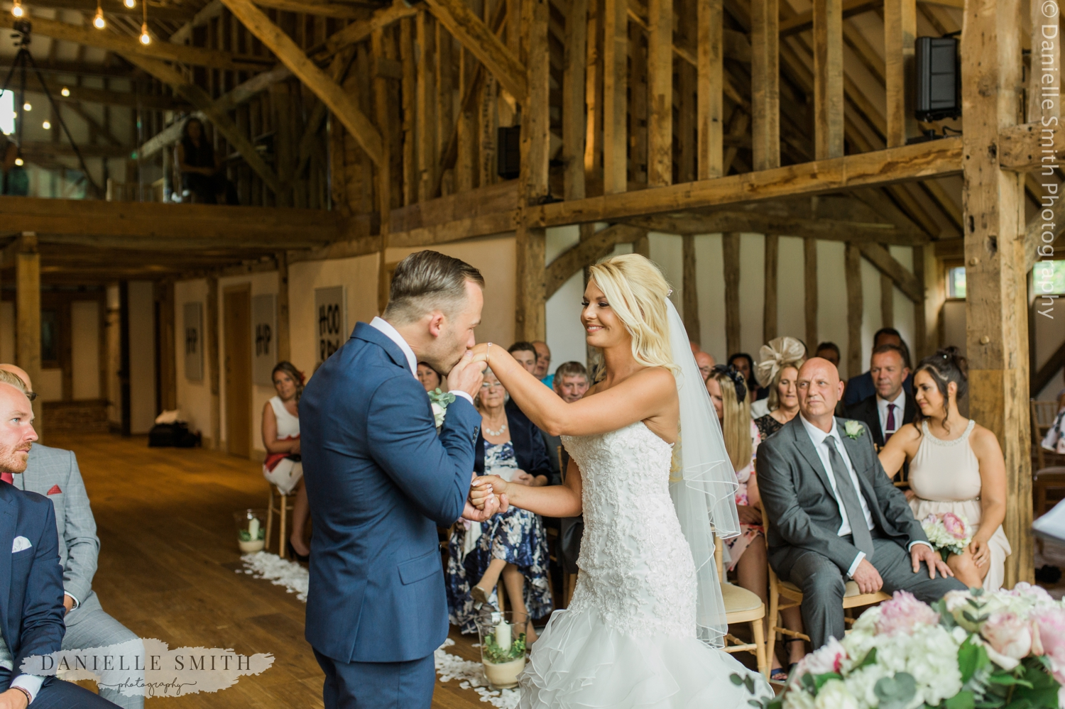 bride and groom getting married in barn