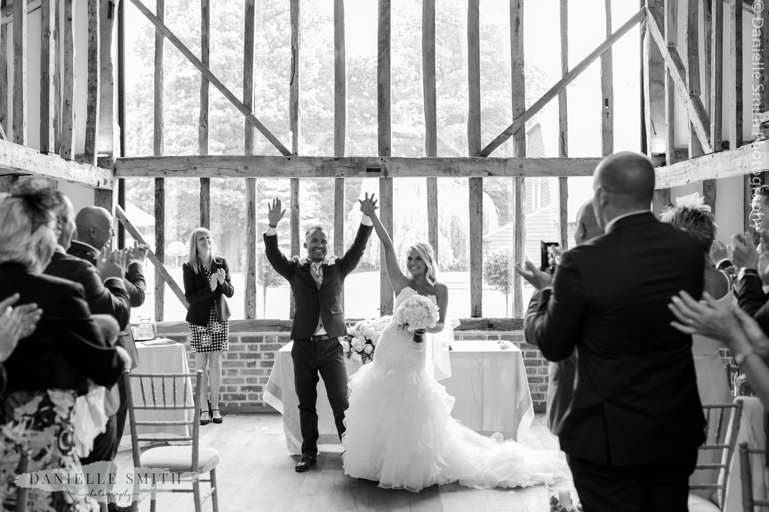 married! bride and groom celebrate at blake hall