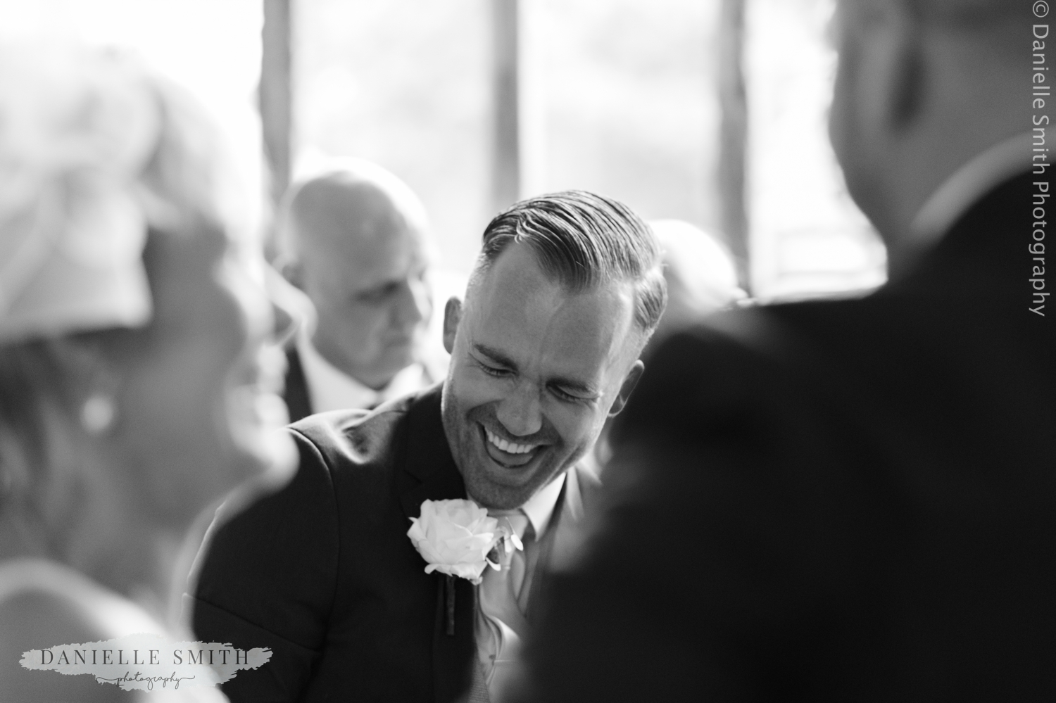 groom laughing at wedding