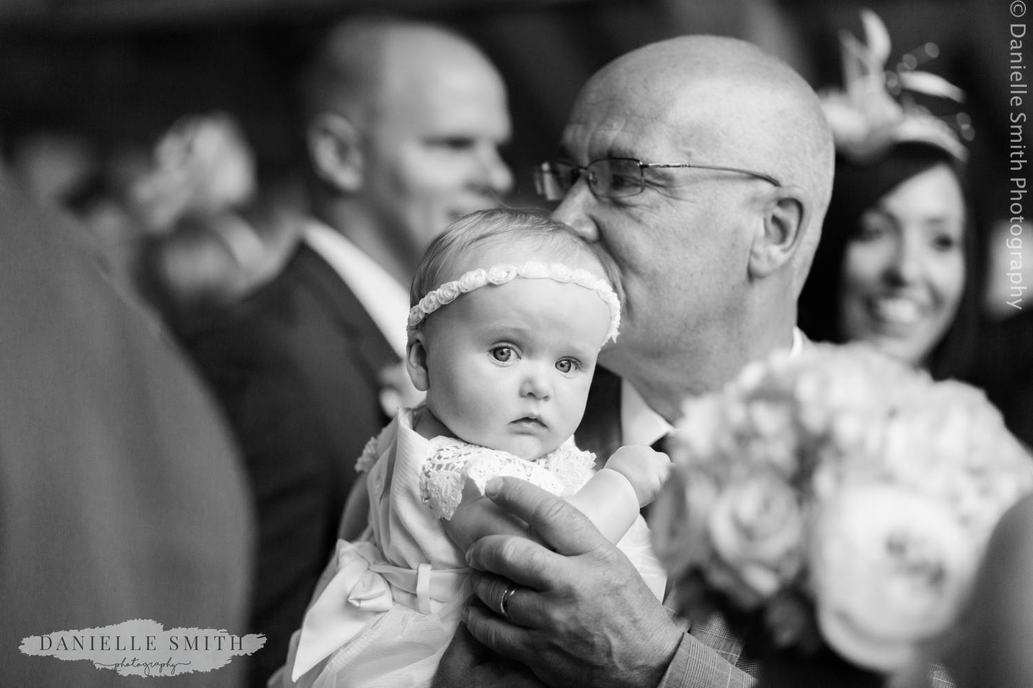 baby flower girl and granddad