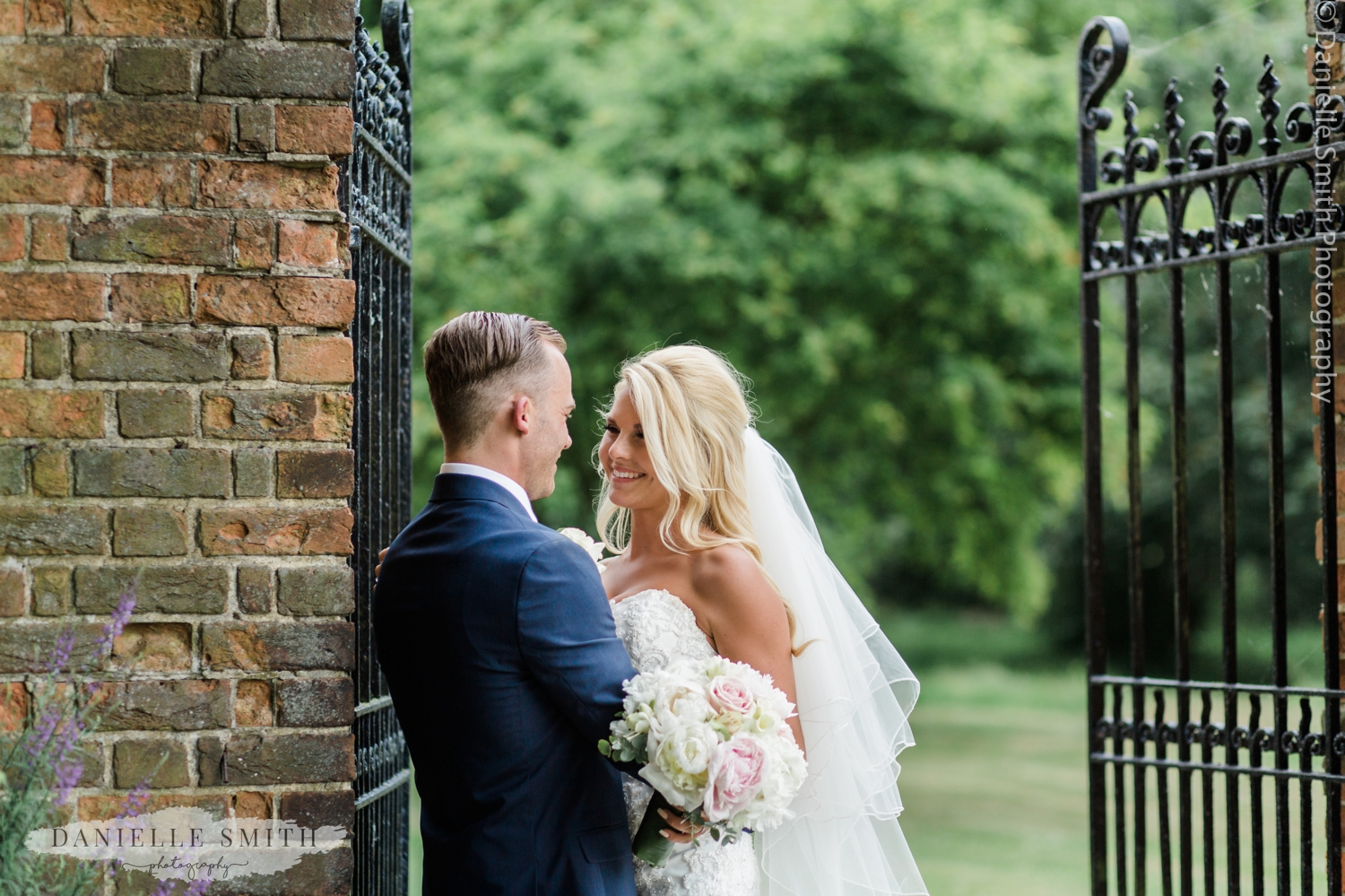bride and groom portrait in gardens at blake hall