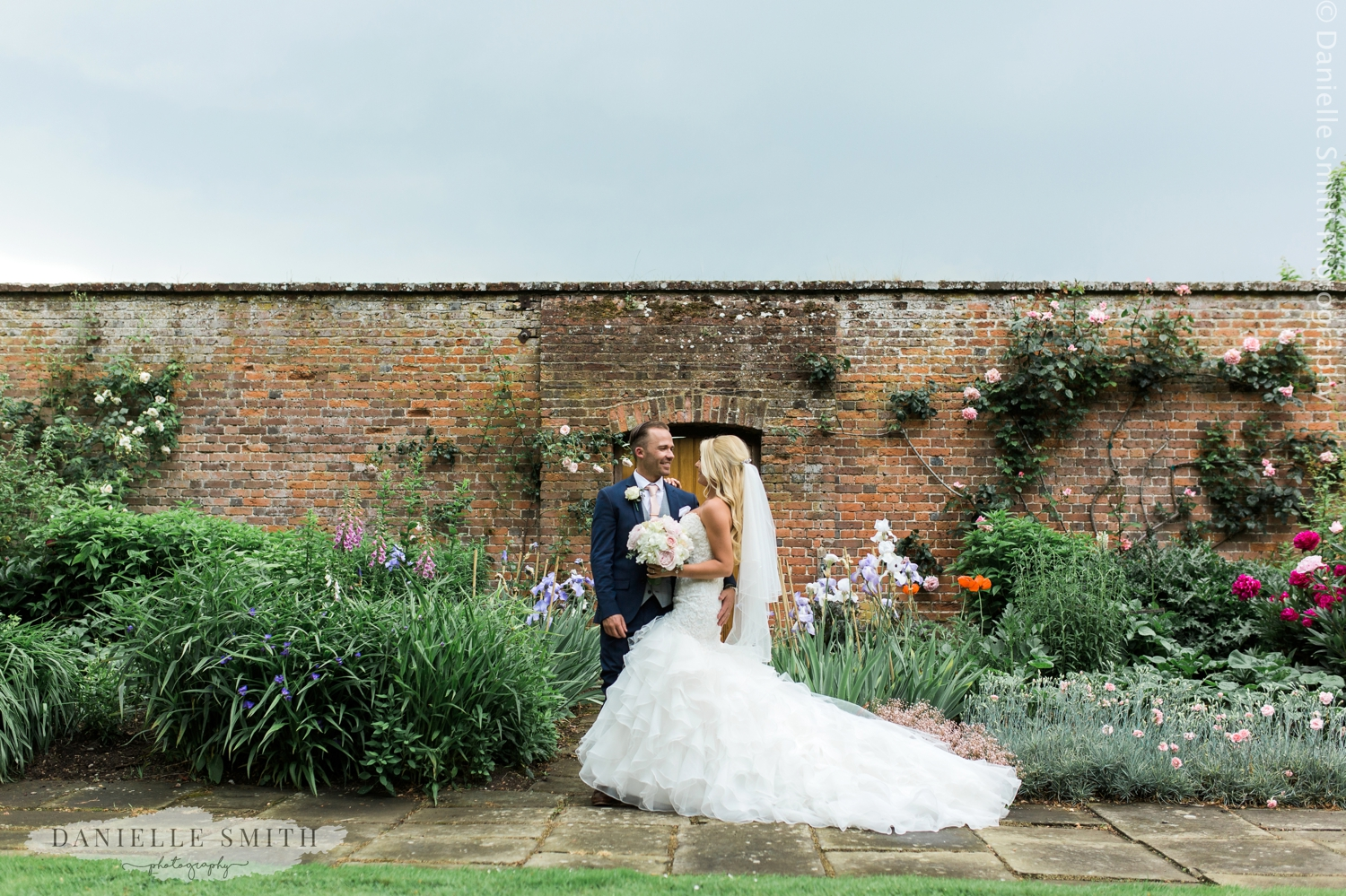bride and groom in gardens - blake hall wedding photographer