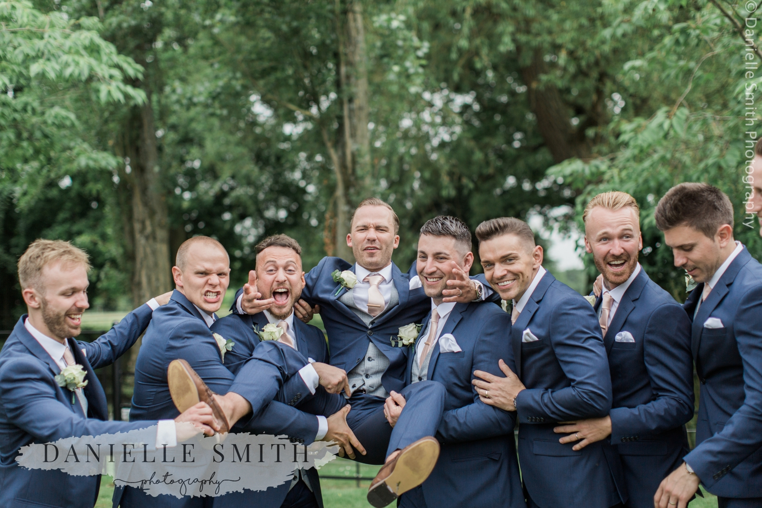 groom and groomsmen messing around at blake hall