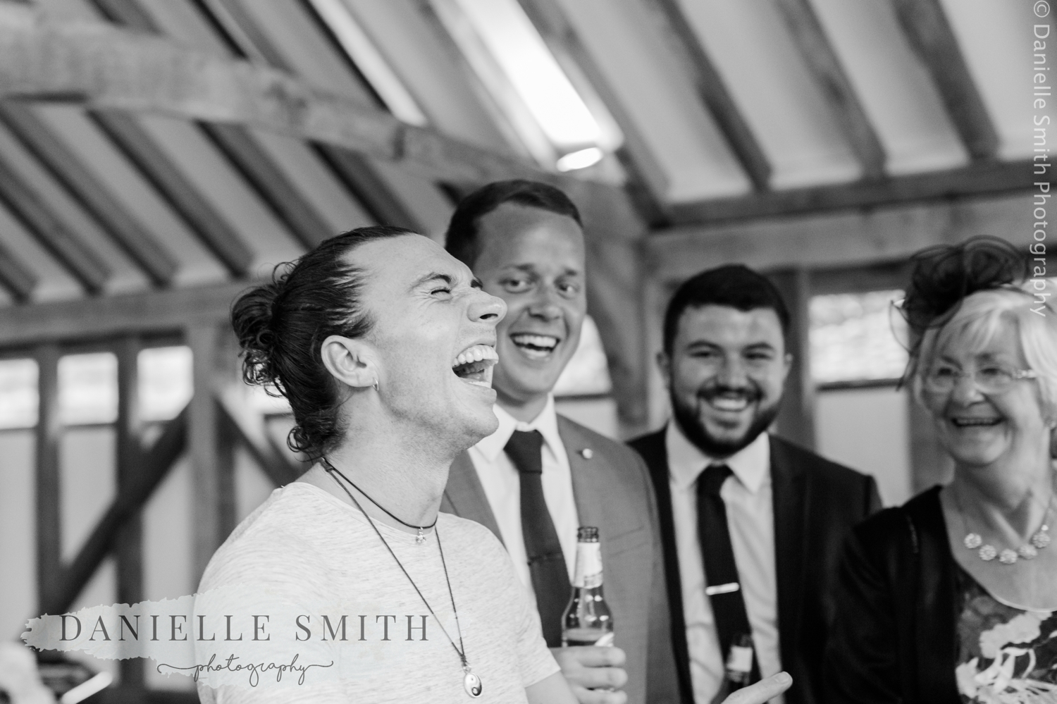 men laughing at wedding