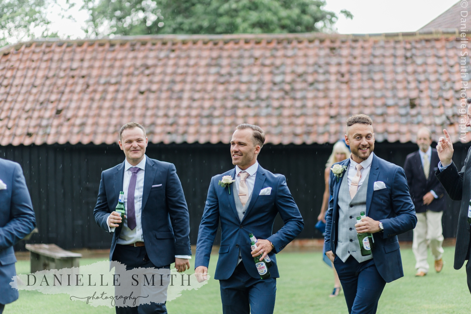 groomsmen walking in gardens