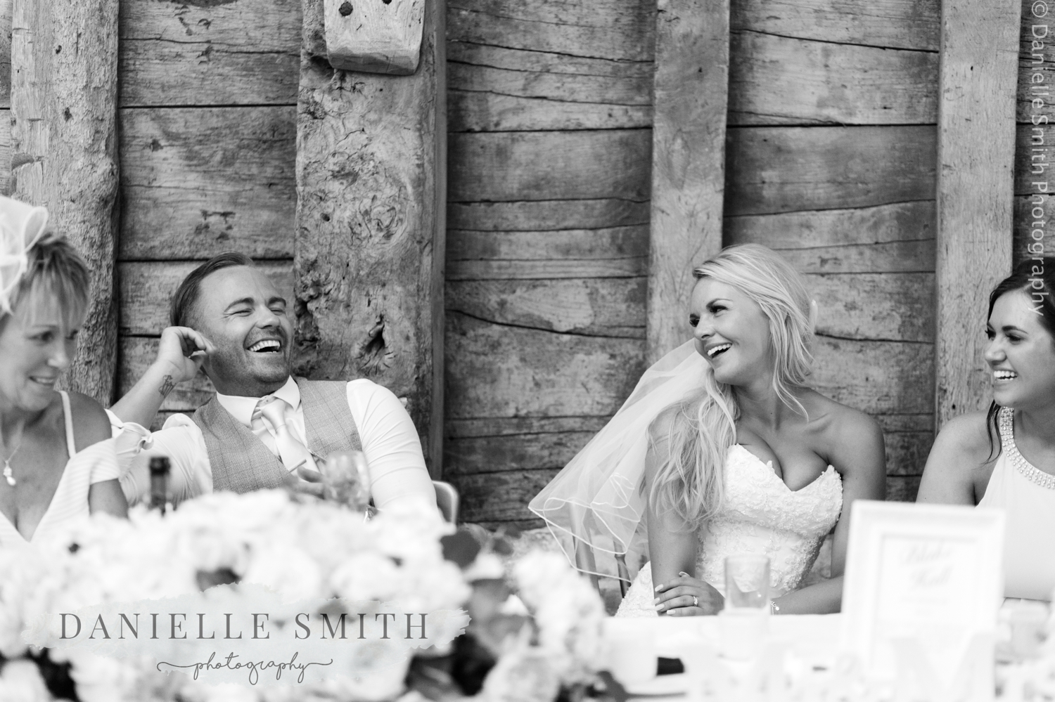 bride and groom laughing at speeches - blake hall wedding