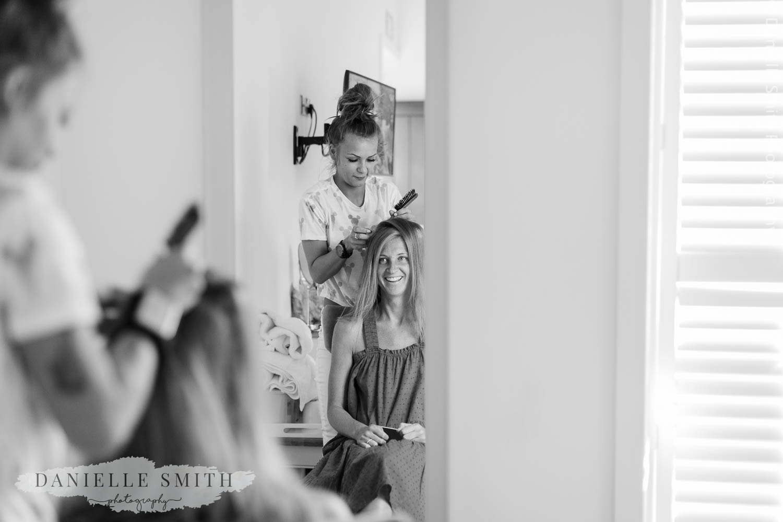 bridesmaid having hair done at stock brook manor