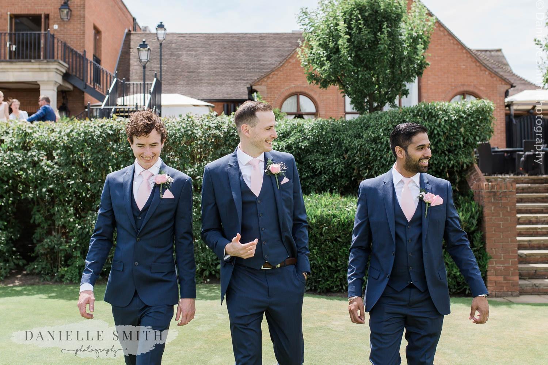 groom and best men walking at stock brook manor