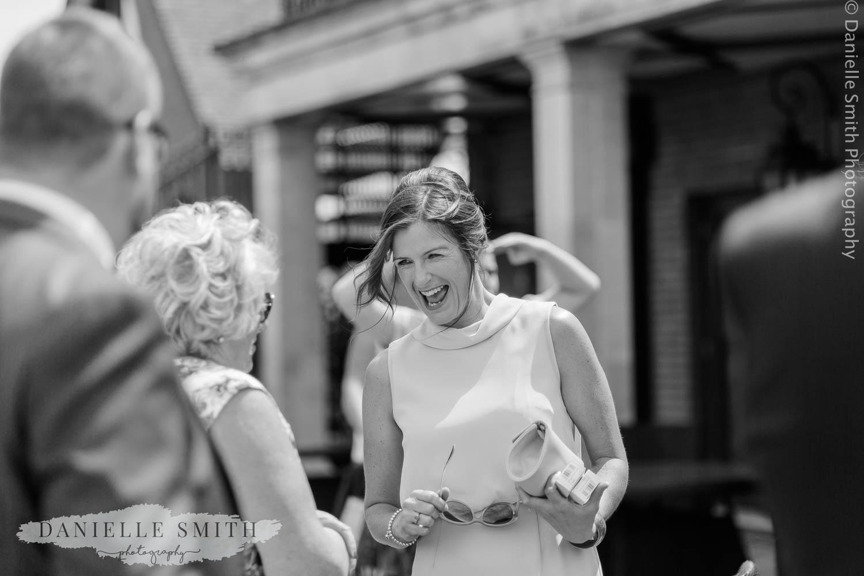 lady laughing at wedding