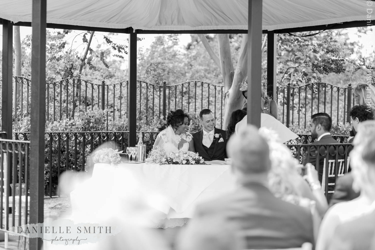 bride and groom signing register at stock brook manor