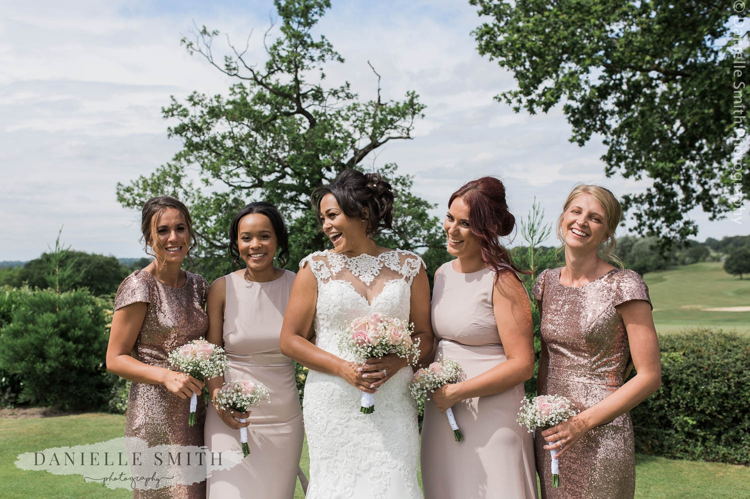 bride and bridesmaids in blush pink and sequin dresses
