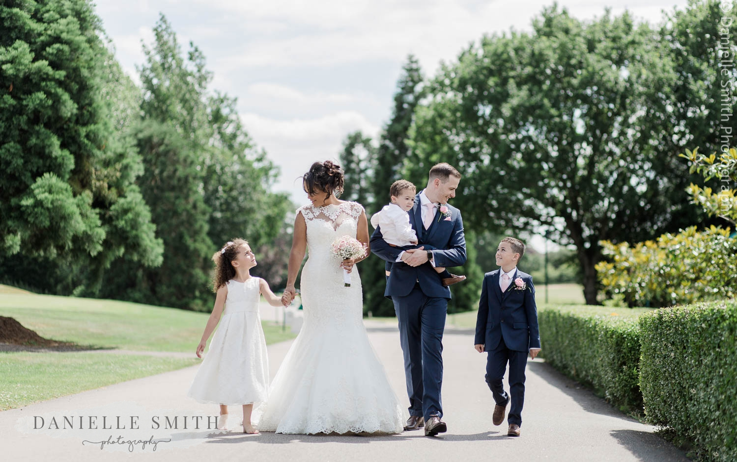 bride and groom and their children at stock brook manor