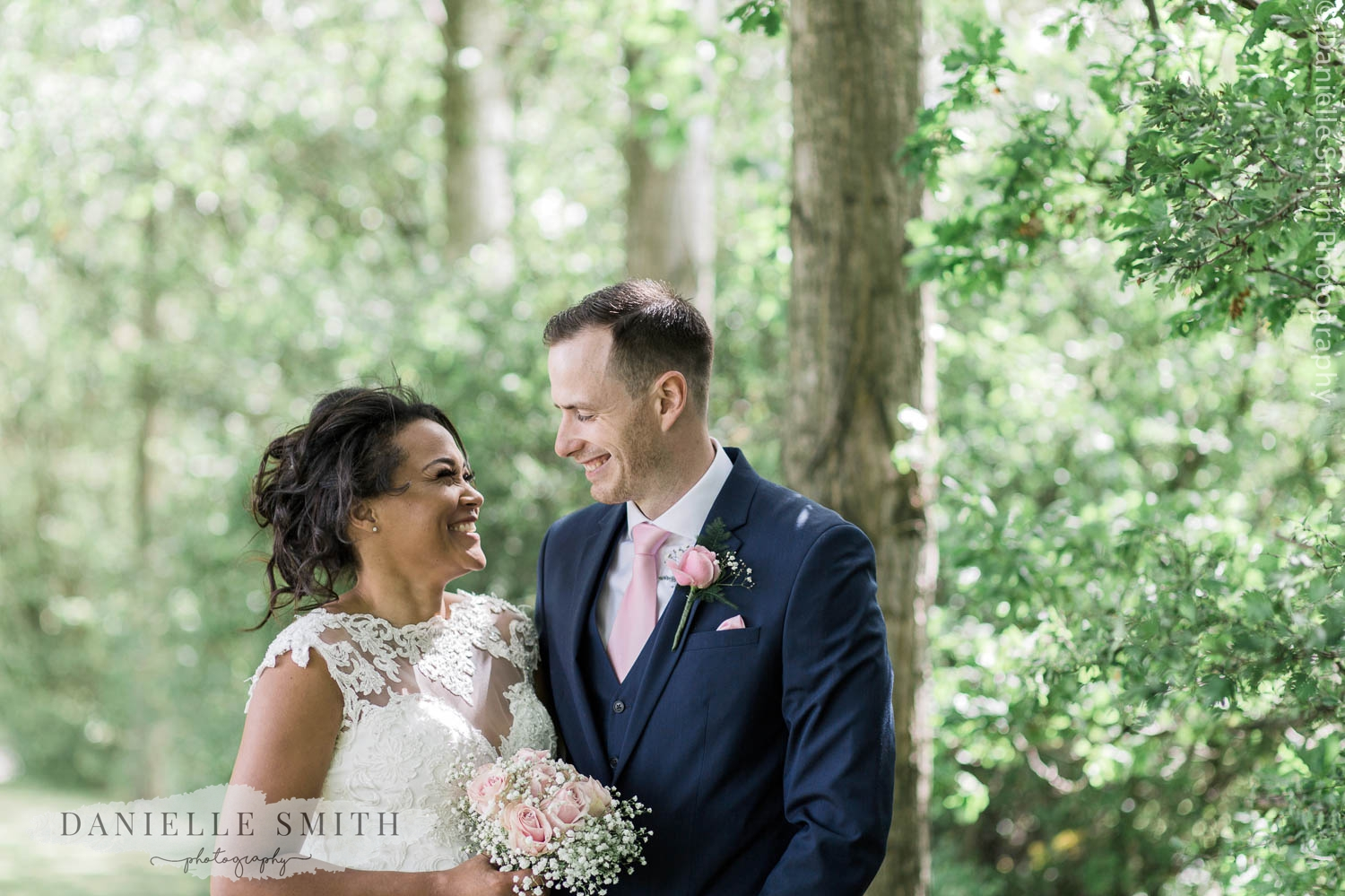 bride and groom smiling at each other at stock brook manor