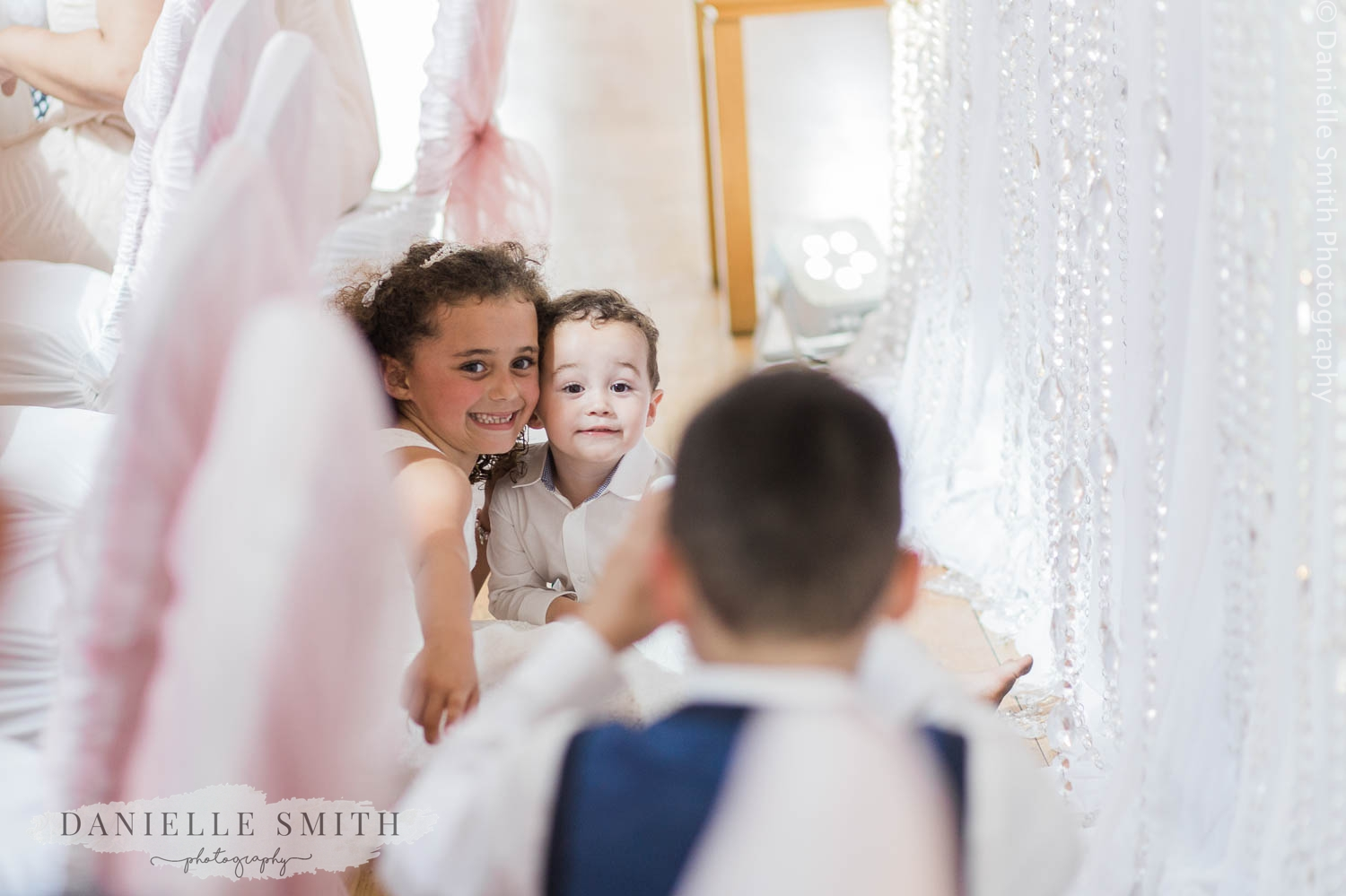 children taking photos of each other at wedding