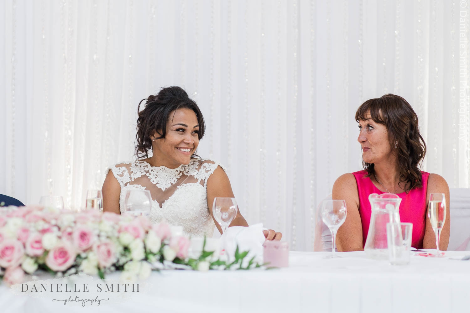 bride smiling at grooms mother