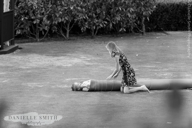 kids playing games in garden at wedding
