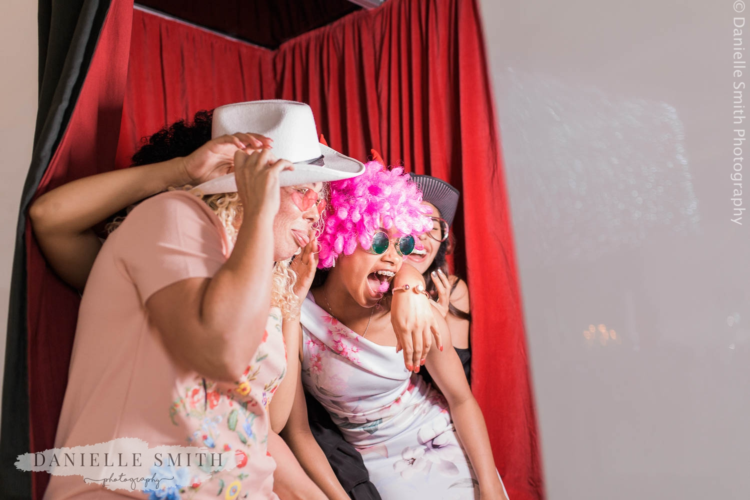 guests in photo booth with props