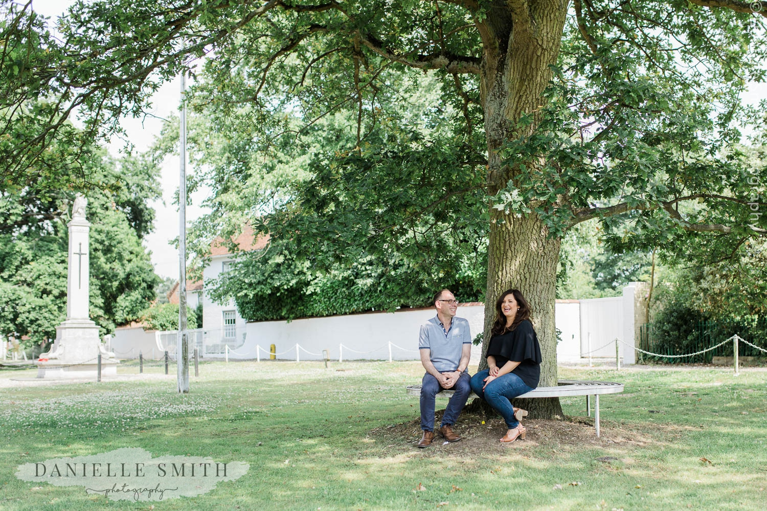 couple laughing under tree
