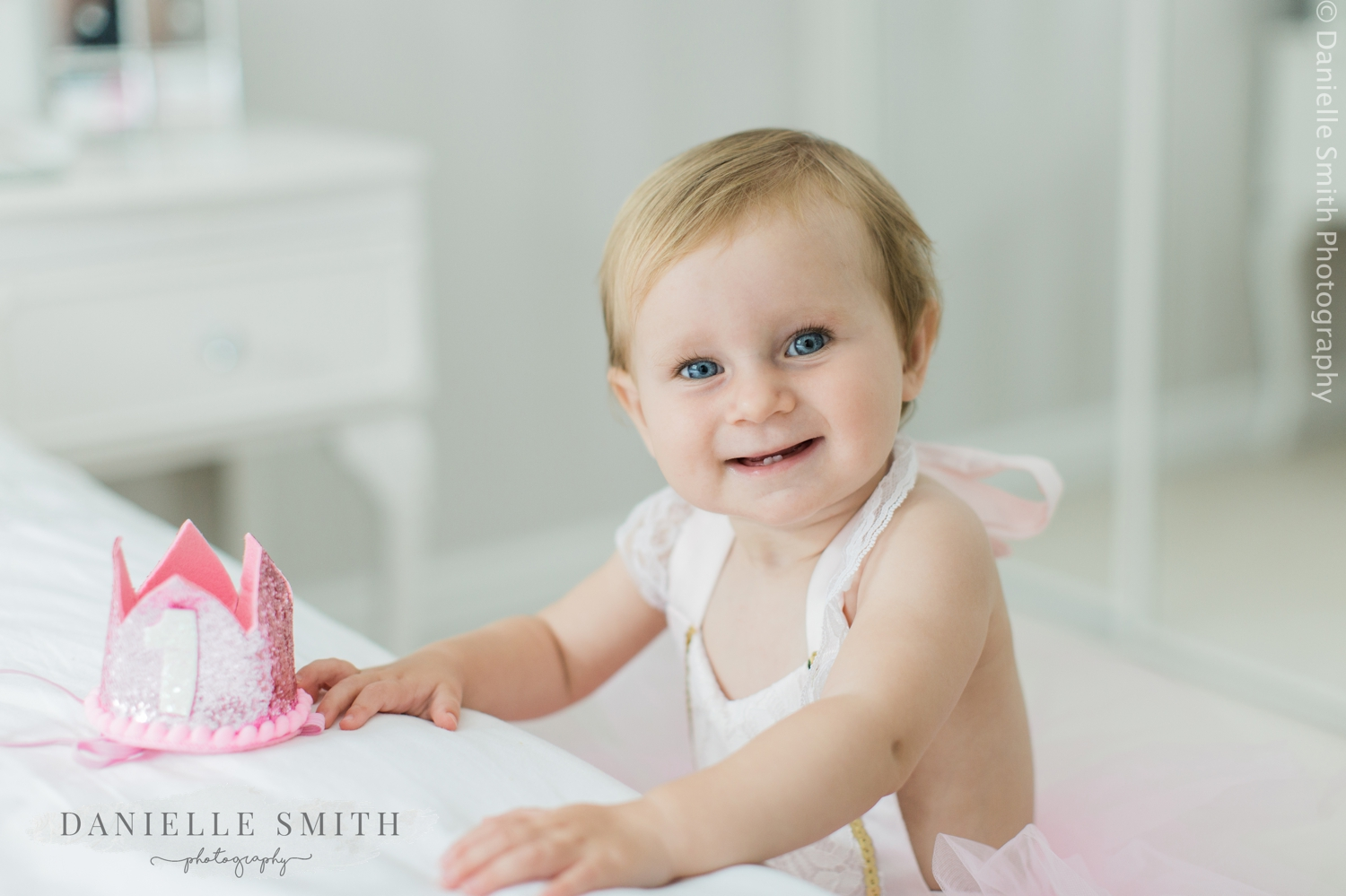 toddler smiling - first birthday photo shoot