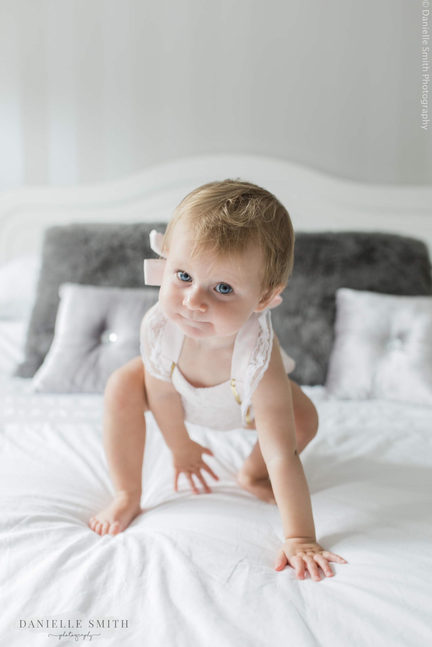 little girl crawling on bed