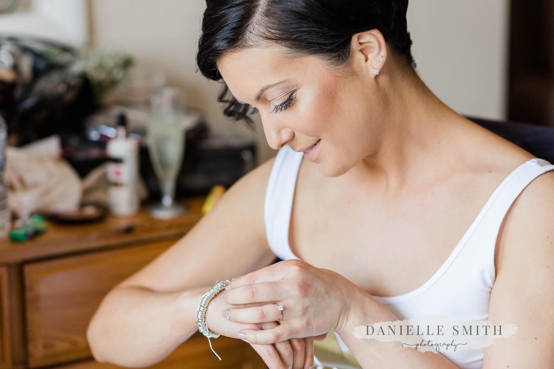 bride looking at her bracelet