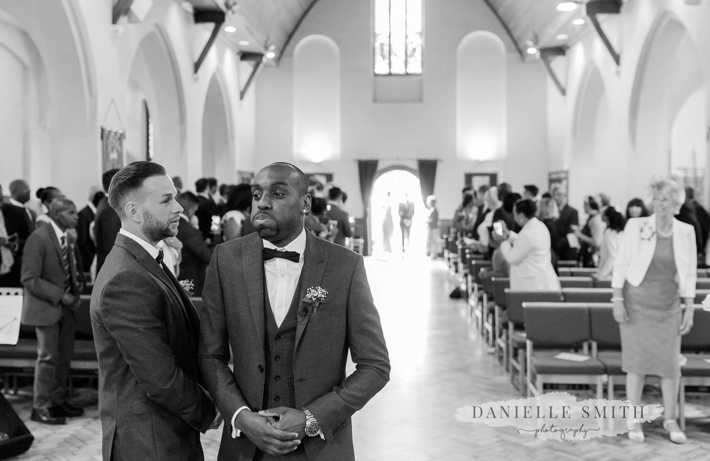 groom looking nervous as he waits