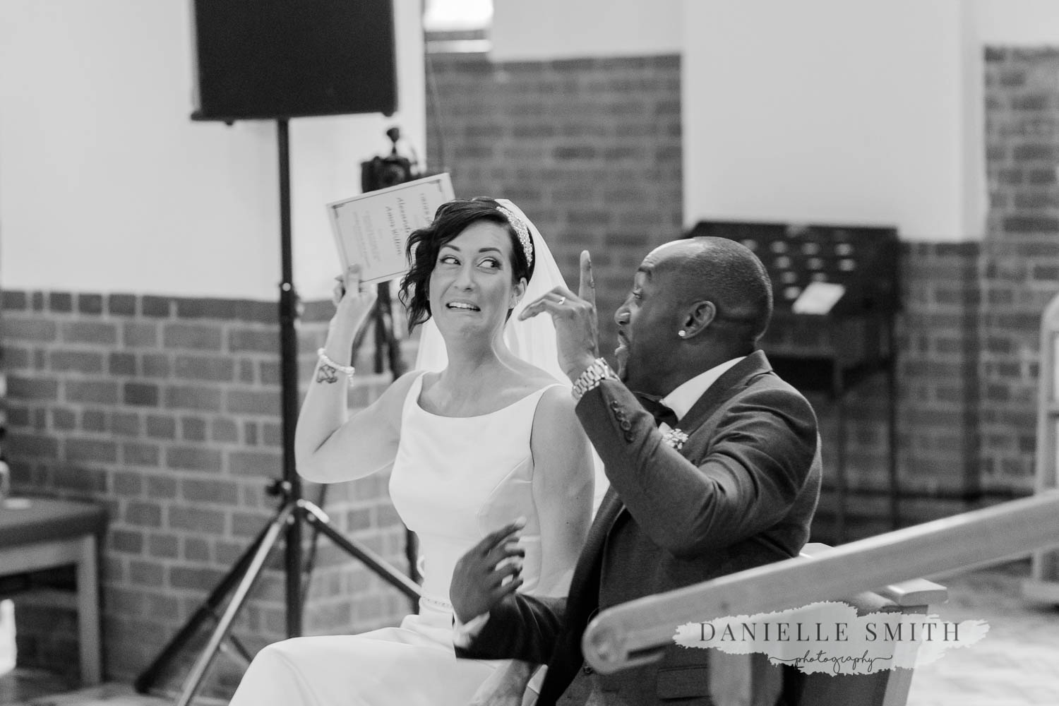 bride and groom putting hands up - laid back wedding