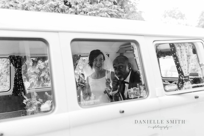 bride and groom through camper van window