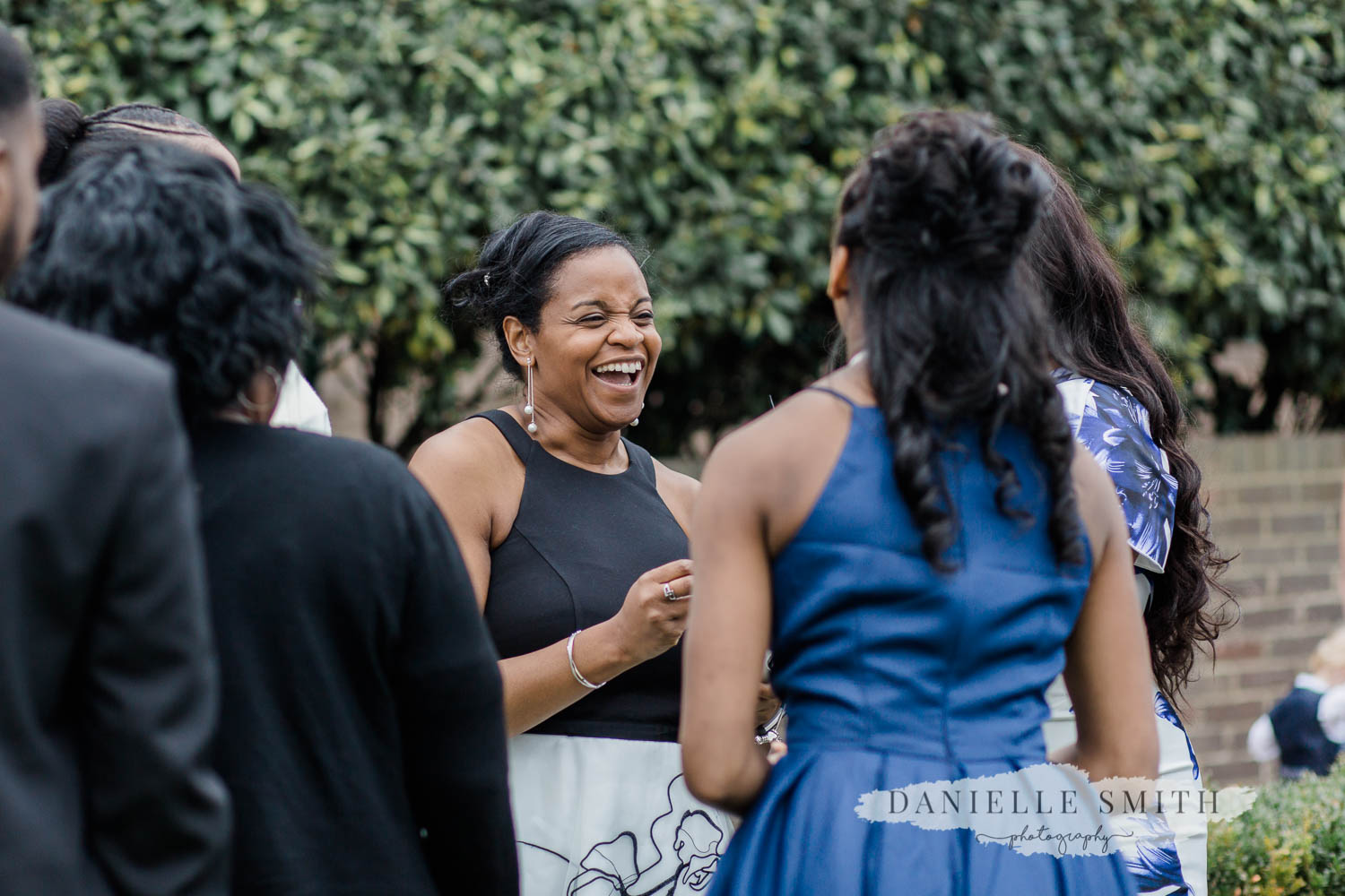 wedding guests laughing - laid back wedding