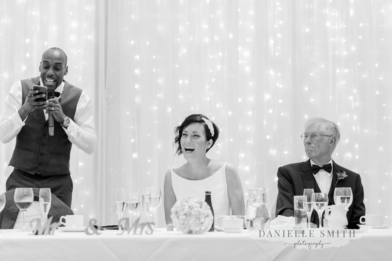 grooms speech bride laughing - laid back wedding