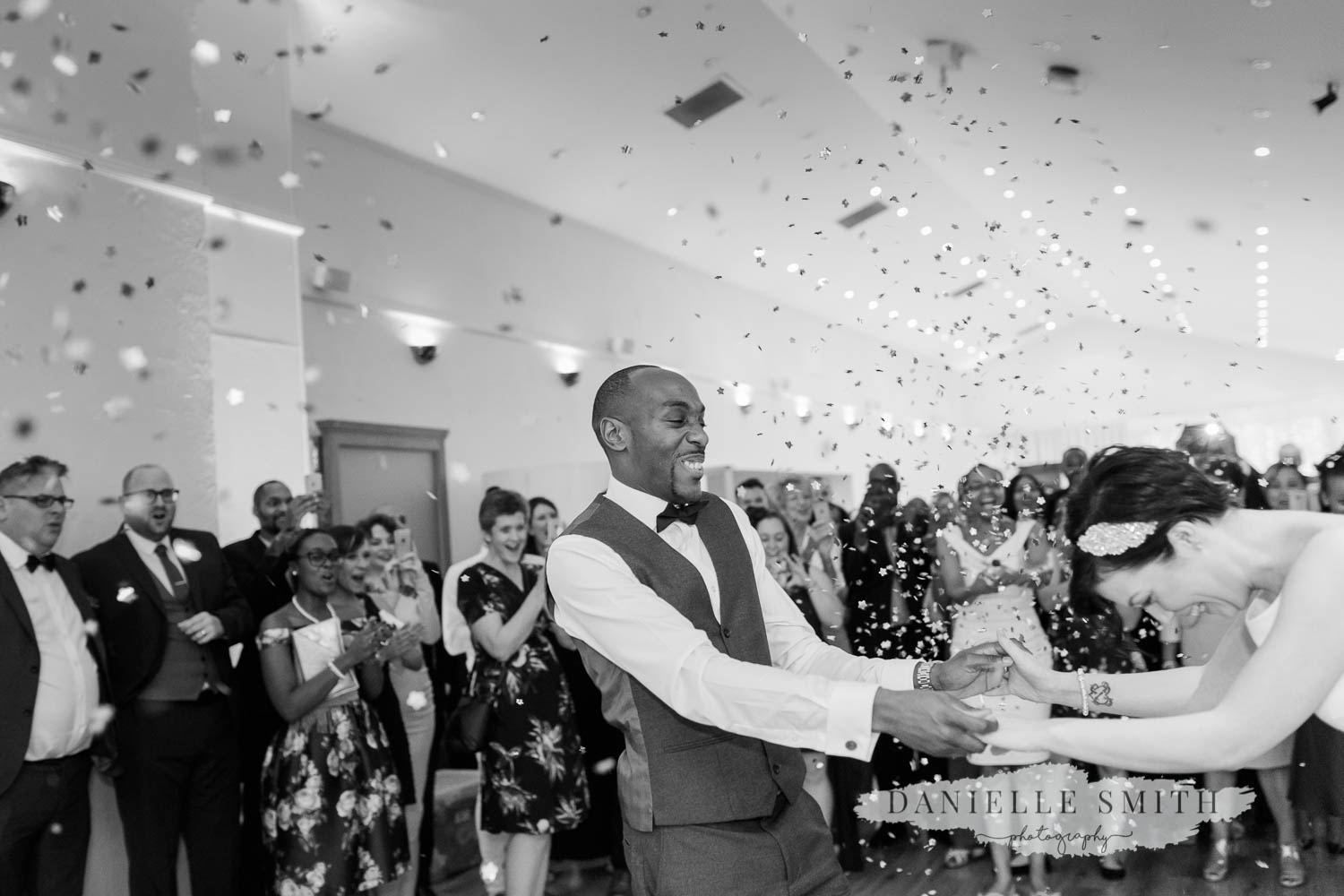 bride and groom first dance with confetti