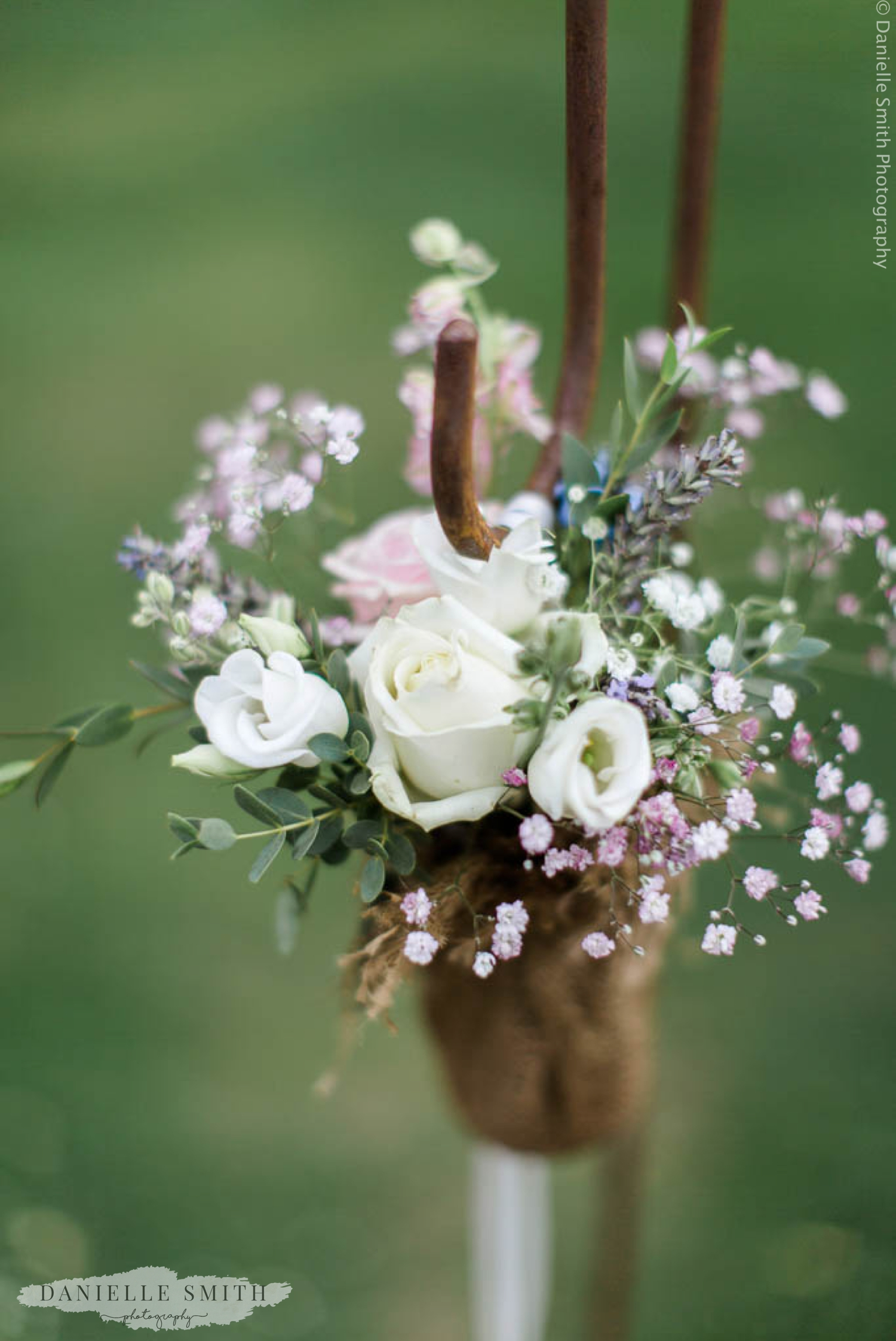 rustic flower decor at outdoor wedding