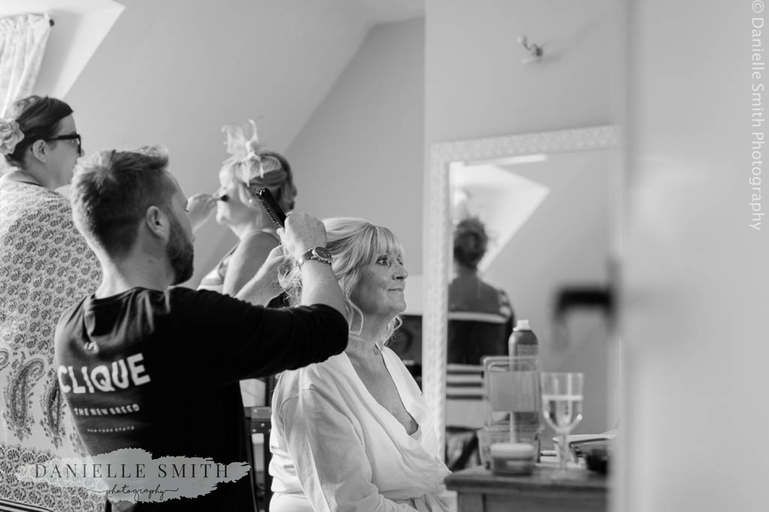 bride having her hair done at houchins wedding