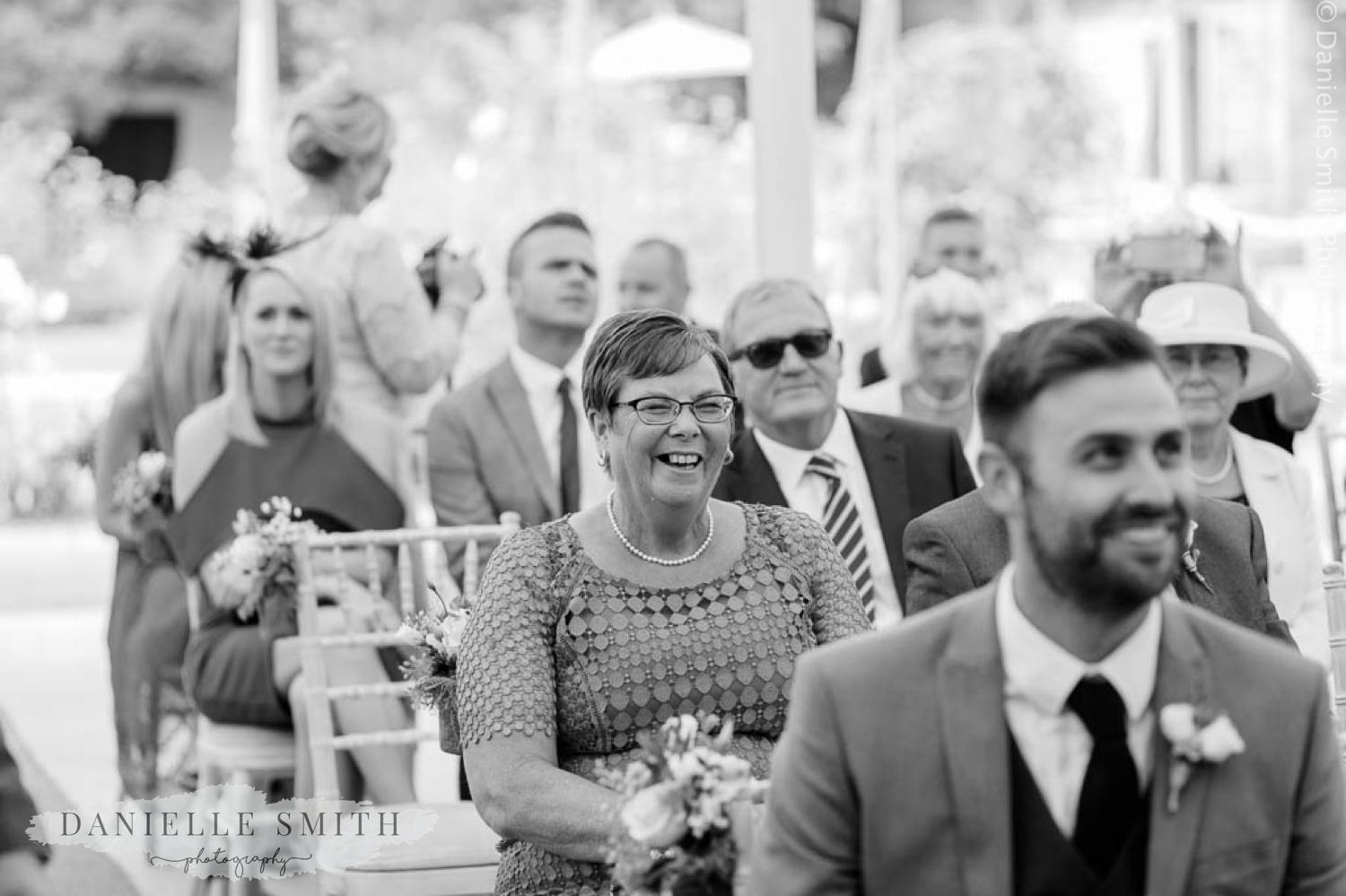 wedding guest laughing - houchins wedding photography