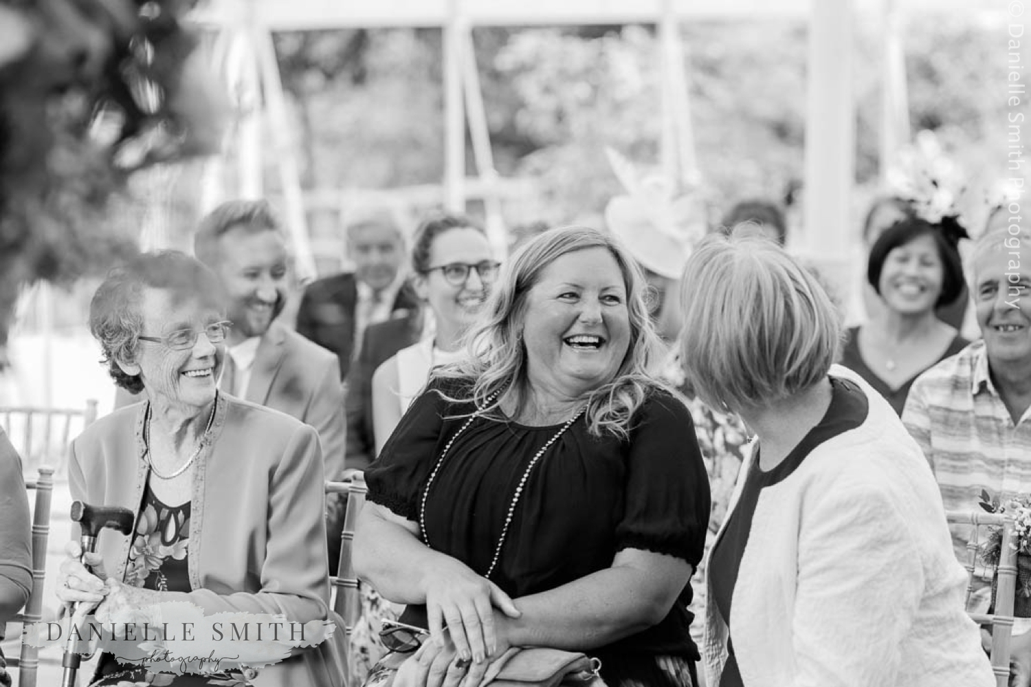 wedding guests laughing - houchins