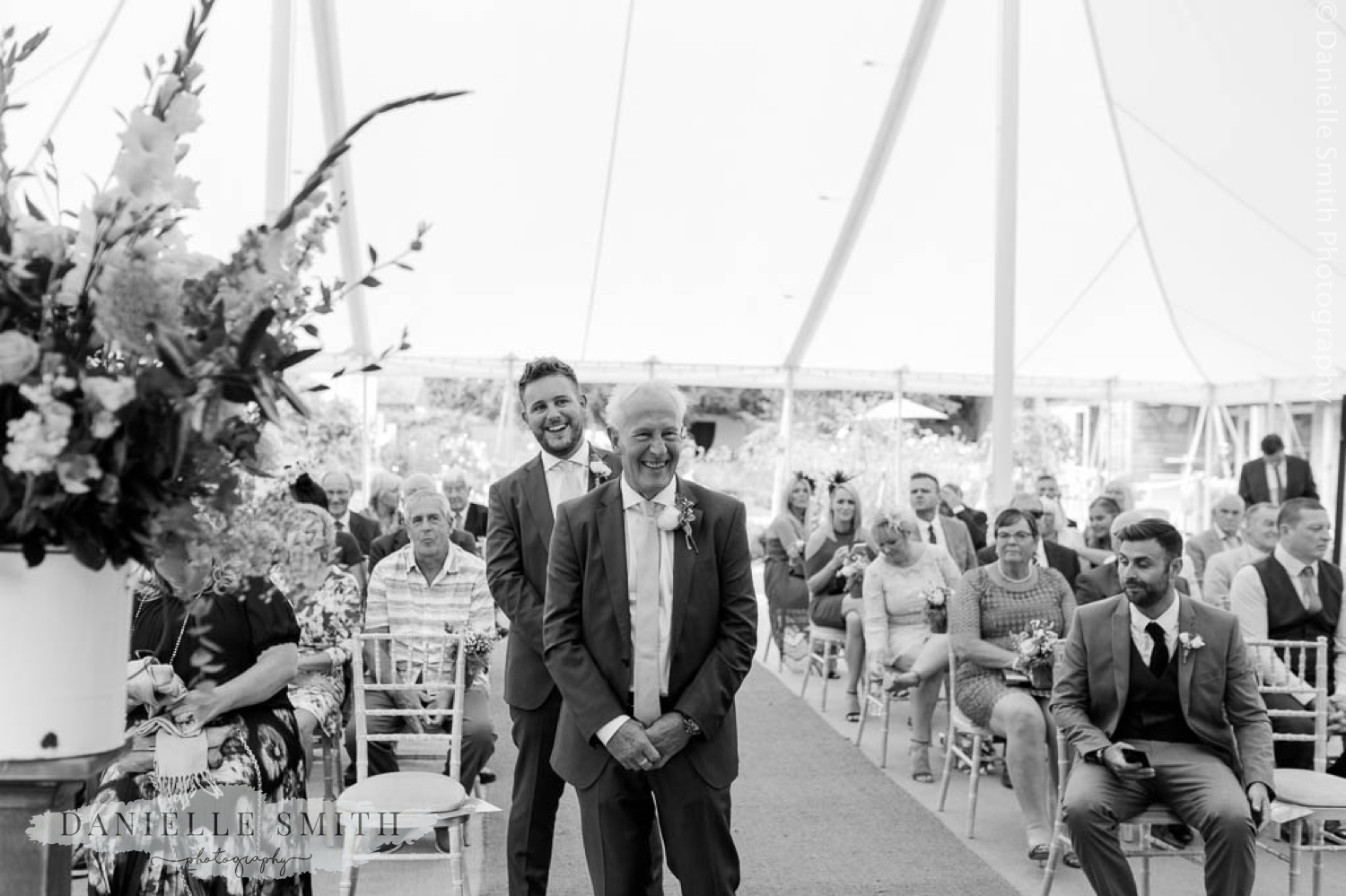groom and best man laughing - outdoor ceremony at houchins
