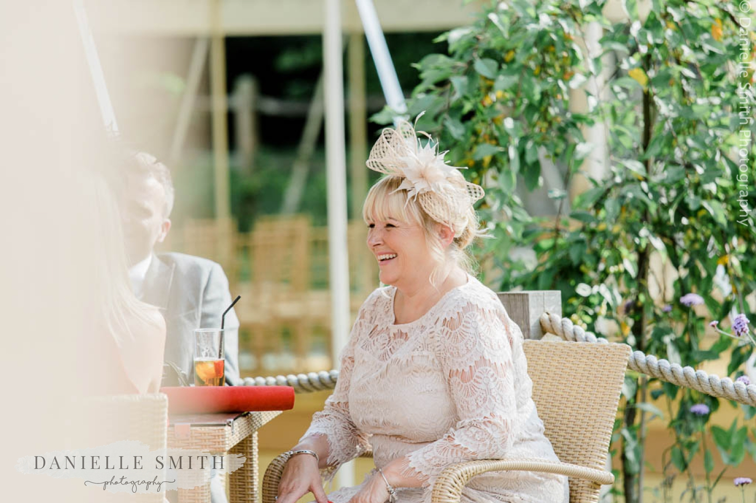 wedding guests smiling at outdoor wedding - houchins