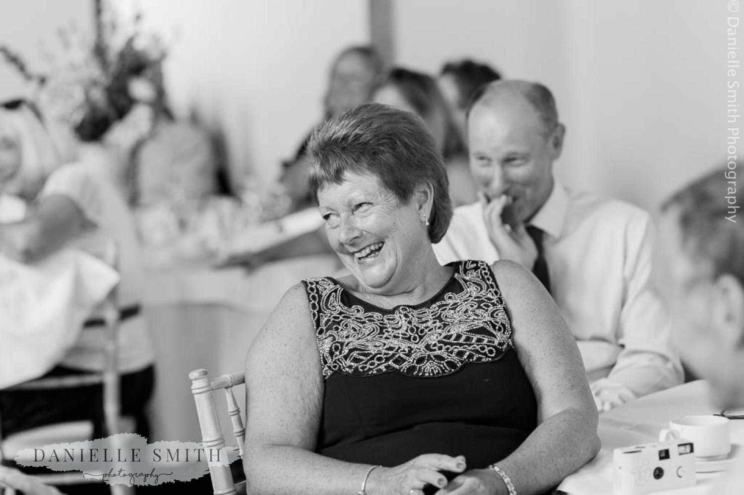 wedding guests laughing at houchins