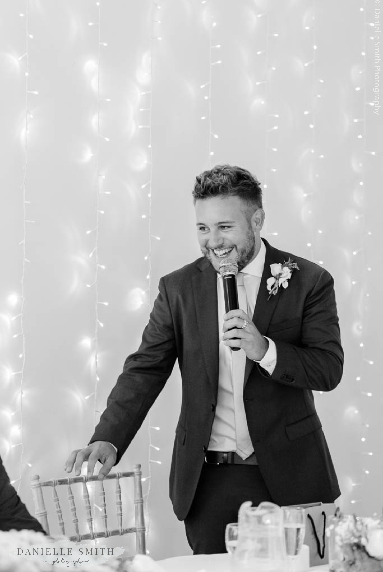 best man smiling during speech