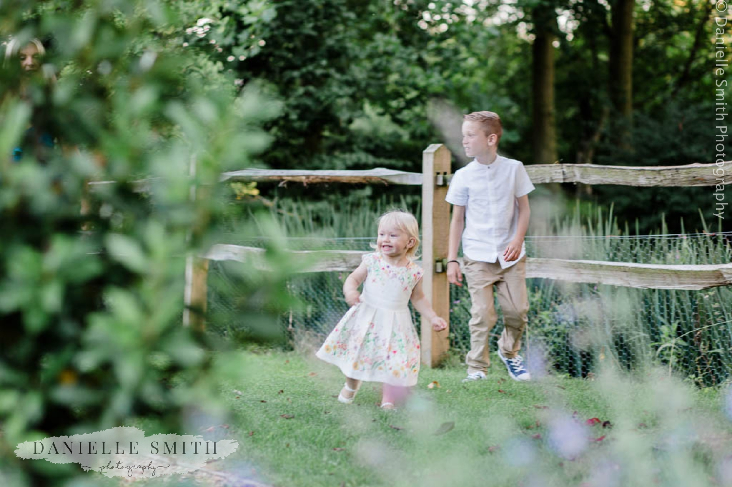 little girl and page boy in gardens