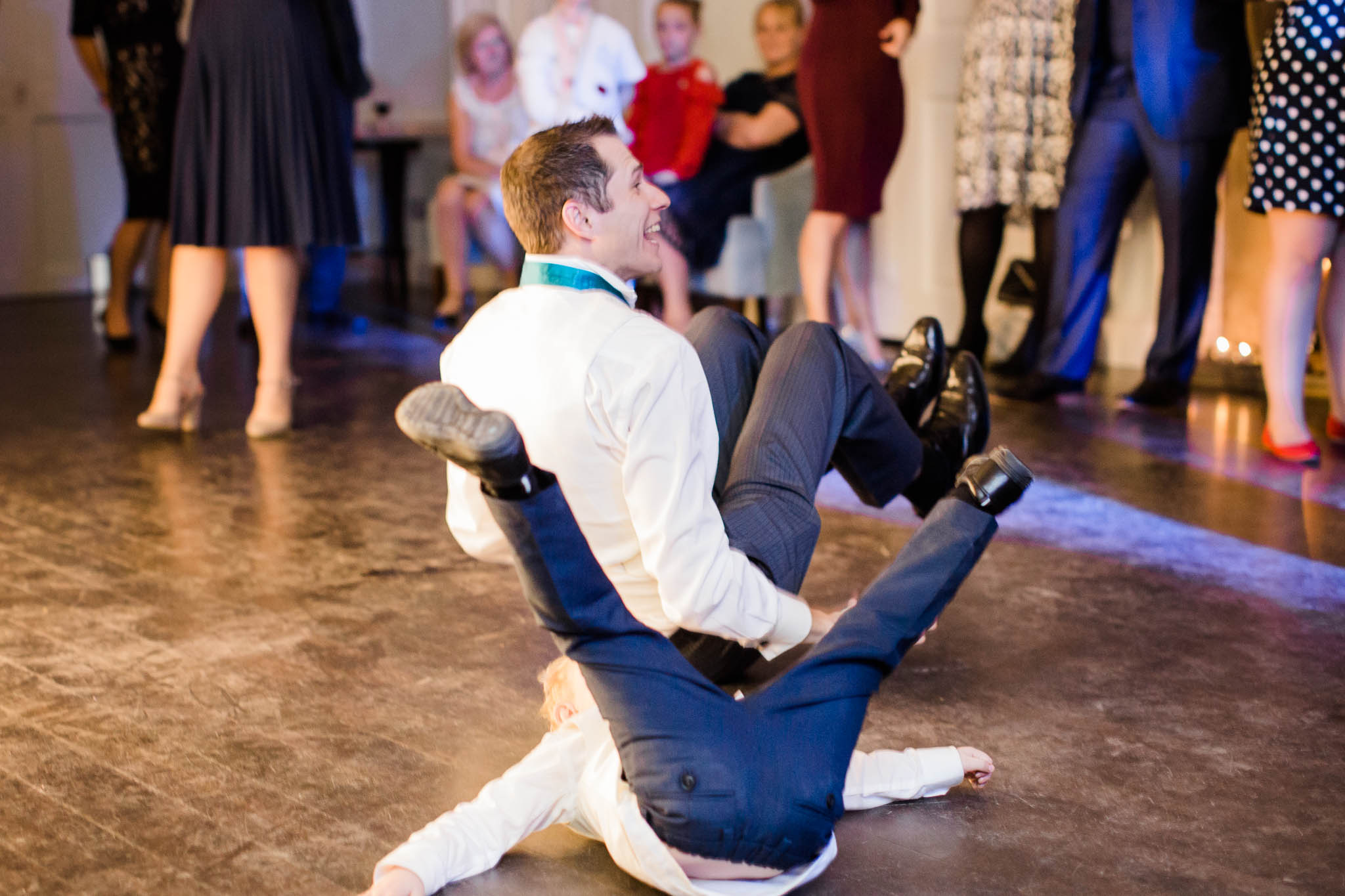man and little boy break dancing at morden hall wedding