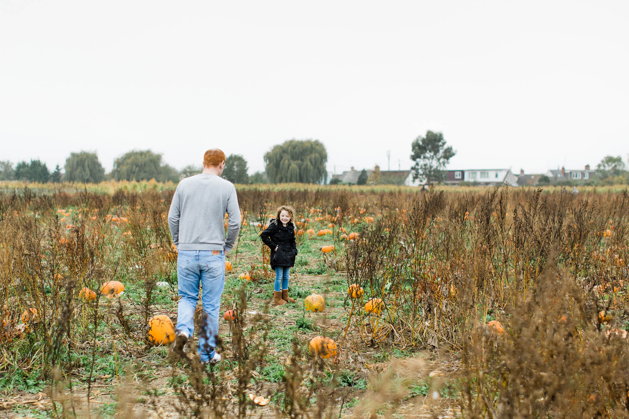 father and daughter pumpkin picking