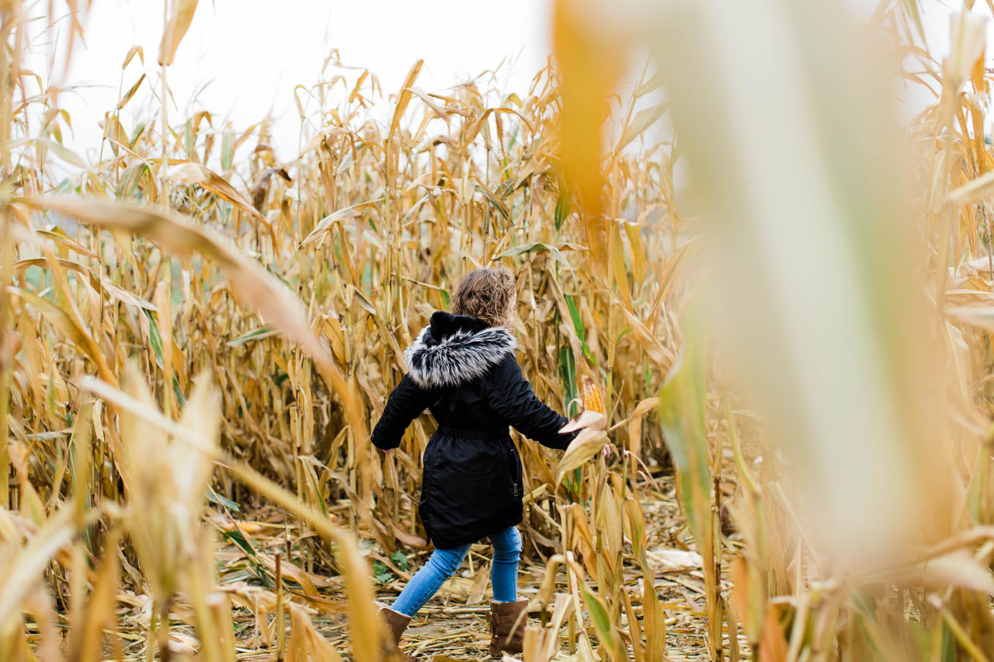 girl walking through corn field