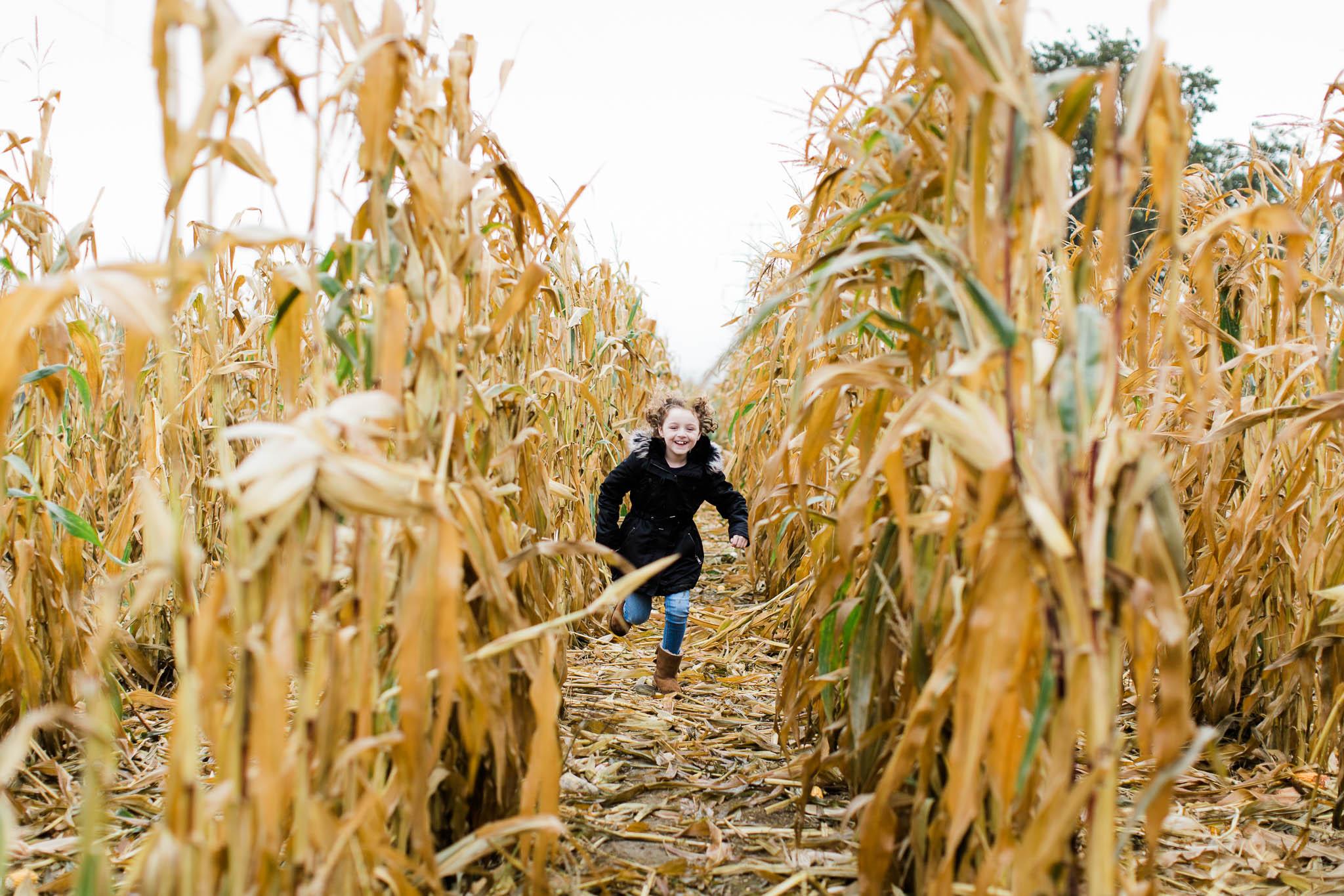 girl running through cornfield
