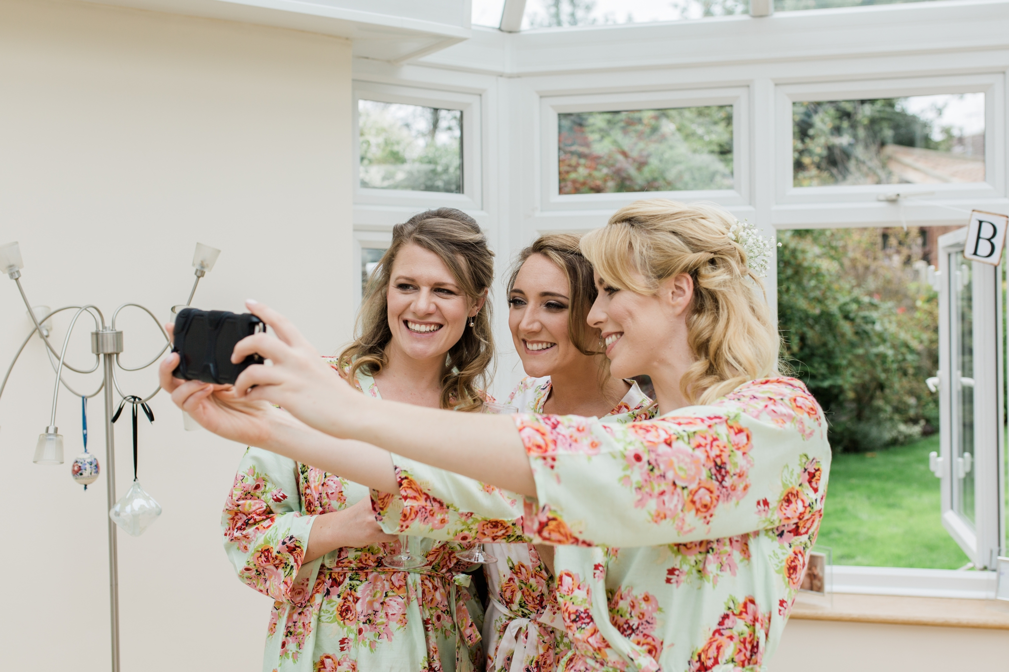 bride having selfie with bridesmaids - relaxed marquee wedding