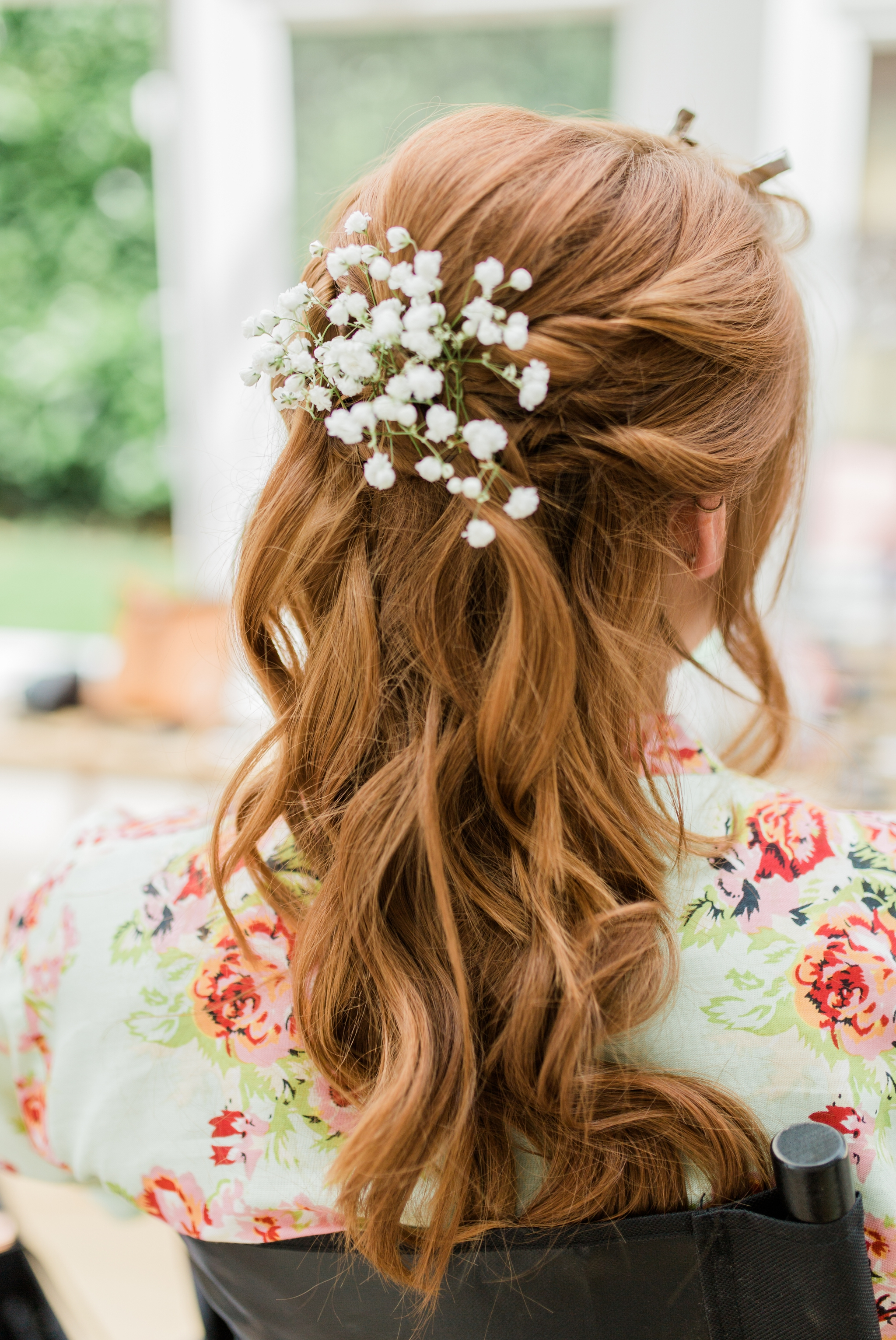 bridesmaid with ginger hair and gypsophila