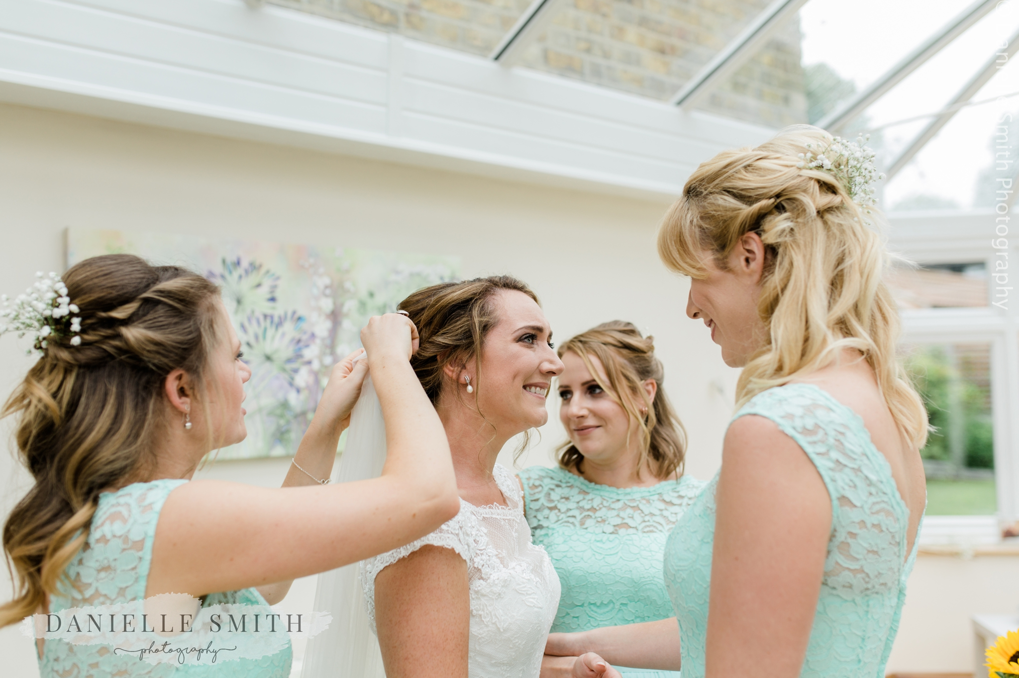 bride teary as bridesmaids help with finishing touches