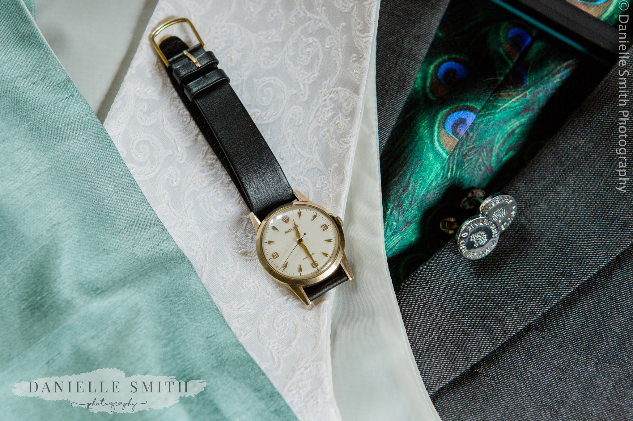 grooms suit and rolex watch