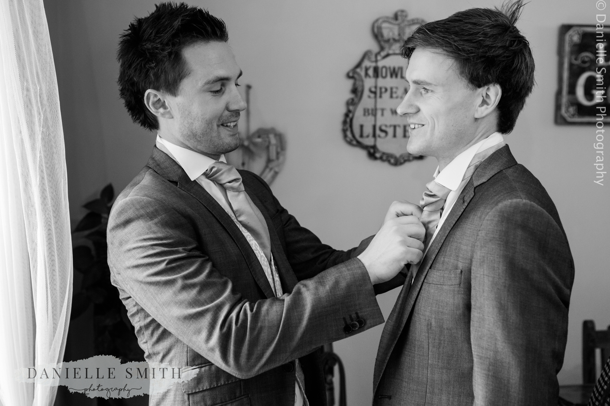 best man helping groom get ready - relaxed marquee wedding
